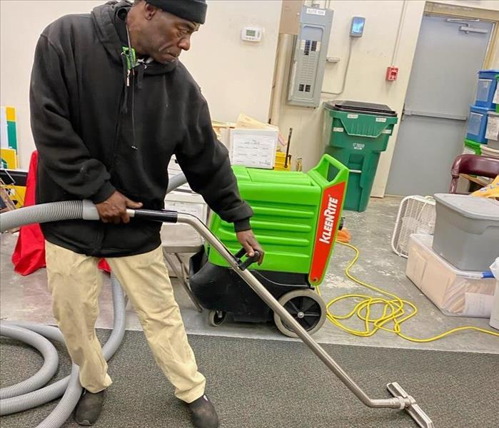SERVPRO technicians with portable pump