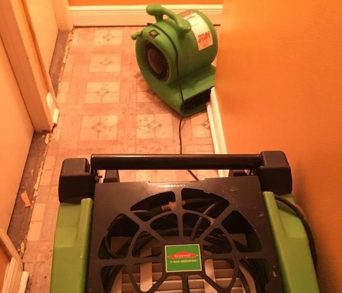 SERVPRO air mover and dehumidifier on tile floor