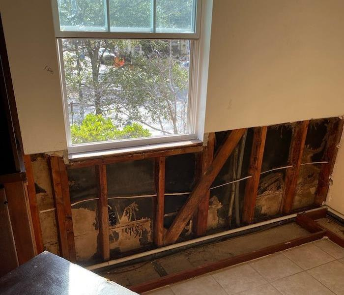 Wall with sheetrock cut away under a window