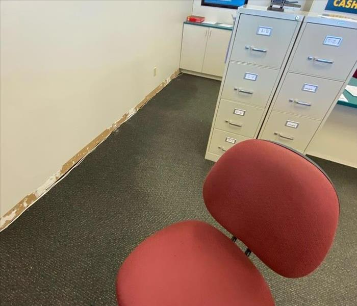 Office with wet carpet and baseboards removed