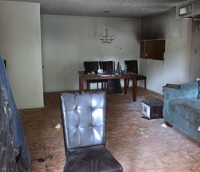 Room with commercial fire damage with chair and sofa