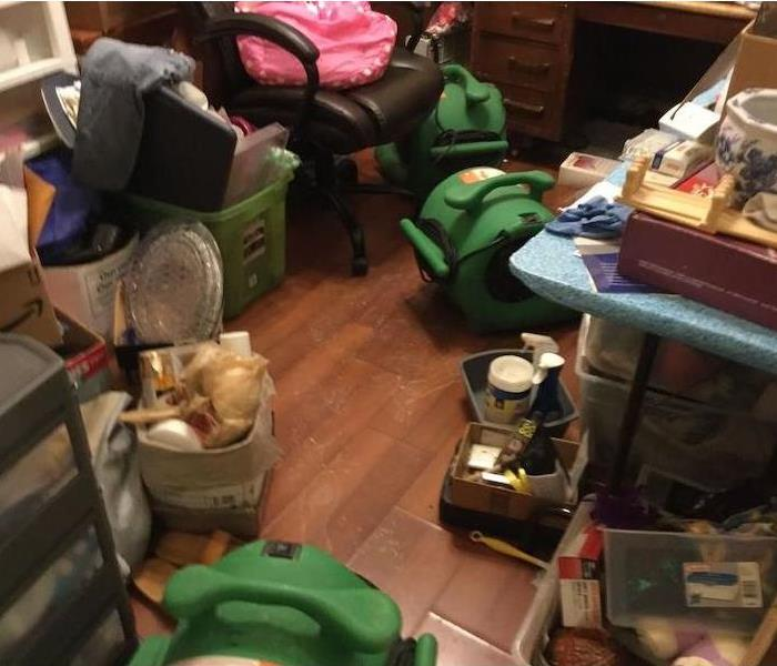 Room with SERVPRO drying equipment and home contents