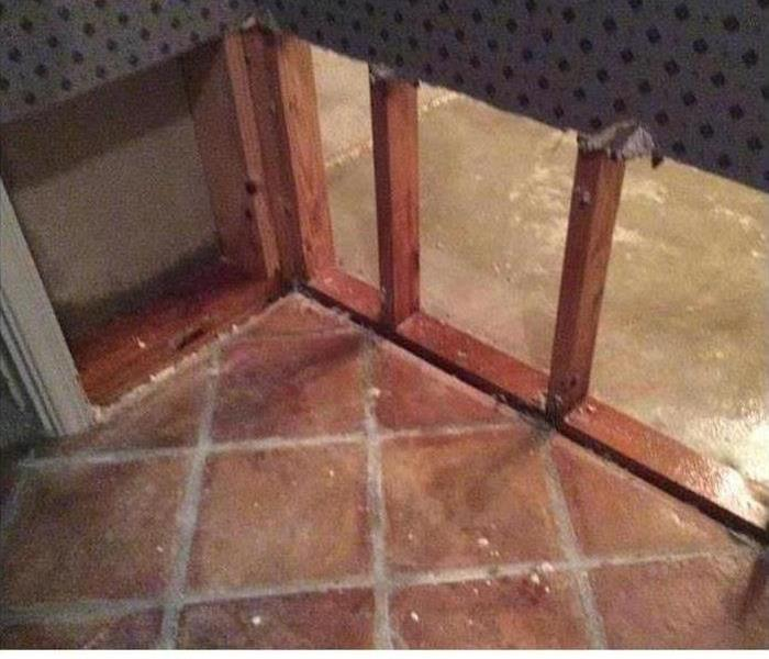Flood Cut on lower wall by red ceramic tile floor