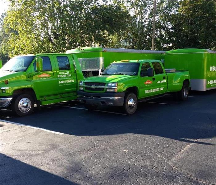 Two SERVPRO trucks with attached service trailers