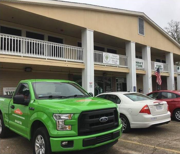 SERVPRO vehicles parked outside building
