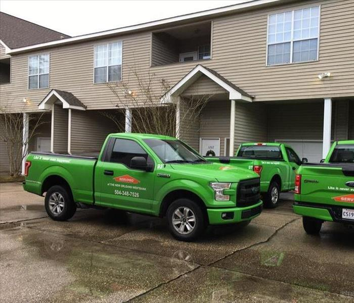 SERVPRO trucks in a parking lot