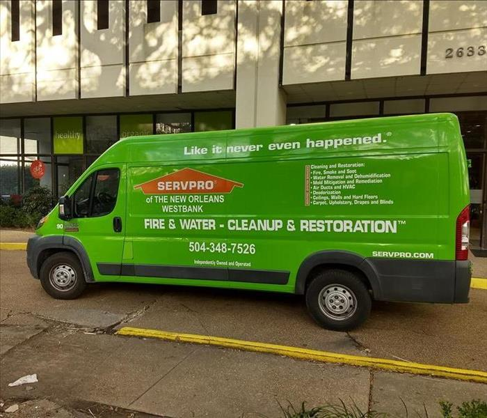 SERVPRO Green Van Parked at Job Site