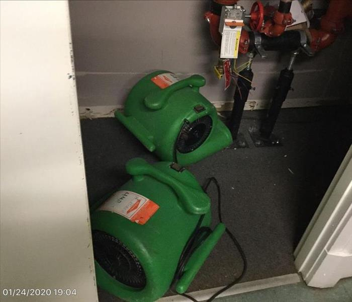 air movers drying flooded closet