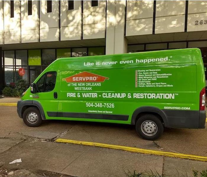 SERVPRO vehicle parked outside building